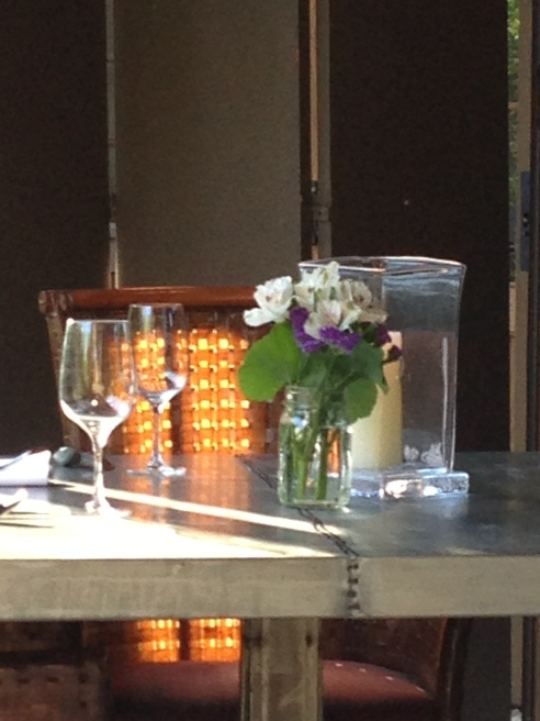 Sun Shining on a Table Scape through Retracted Glass Walls